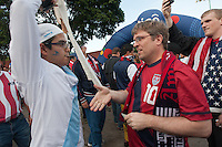 A Guatemalan fan refuses to shake the hand of a USA fan before the United States played Guatemala at Estadio Mateo Flores in Guatemala City, Guatemala in a World Cup Qualifier on Tue. June 12, 2012.
