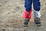 A refugee girl, who arrived on the Greek island of Lesbos with wet feet on October 31, 2015, received dry socks from Norwegian volunteers, who then wrapped her feet in plastic bags before putting her shoes back on. She and her family arrived in a small boat from Turkey. The boat was provided by Turkish traffickers to whom the refugees paid huge sums to arrive in Greece.
