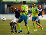 Seattle Sounders Leo Gonzales (12) and New England RevolutionTeal Bunbury (10) go for the ball during an MLS match on March 8, 2015 in Seattle, Washington.  The Sounders beat the Revolution 3-0.  Jim Bryant Photo. ©2015. All Rights Reserved.