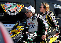 Feb. 15, 2013; Pomona, CA, USA; NHRA funny car driver John Force (left) with daughter, top fuel dragster driver Brittany Force during qualifying for the Winternationals at Auto Club Raceway at Pomona. Mandatory Credit: Mark J. Rebilas-