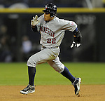 CHICAGO - SEPTEMBER 23:  Carlos Gomez #22 of the Minnesota Twins runs towards second base after hitting an RBI double in the fourth inning against the Chicago White Sox on September 23, 2009 at U.S. Cellular Field in Chicago, Illinois.  (Photo by Ron Vesely)