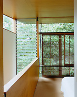 The wooden shutters and louvered windows throughout the house control sunlight and allow air to circulate