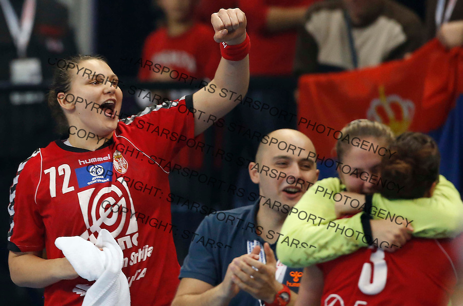 BELGRADE, SERBIA - DECEMBER 20: Dragana Cvijic (L) of Serbia celebrates victory after the World Women's Handball Championship 2013 Semi Final match between Poland and Serbia at Kombank Arena Hall on December 20, 2013 in Belgrade, Serbia. (Photo by Srdjan Stevanovic/Getty Images)