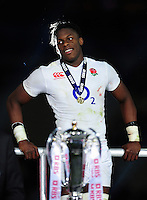 Maro Itoje of England looks on after the match on the winners' podium. RBS Six Nations match between France and England on March 19, 2016 at the Stade de France in Paris, France. Photo by: Patrick Khachfe / Onside Images