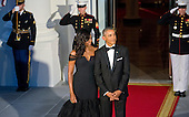 United States President Barack Obama smiles as he and First Lady Michelle Obama await the arrival of President XI Jinping of China and Madame Peng Liyuan to a State Dinner in their honor on the North Portico of the White House in Washington, DC on Friday, September 25, 2015.<br /> Credit: Ron Sachs / CNP