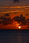 12 August 2009: The sun sets in the Caribbean Sea at Captain Don's Reef in Hato, Bonaire. Captain Don's Habitat is a major SCUBA diving resort, hosting thousands of divers annually, with diving available to guests 24 hours-a-day. Mandatory Photo Credit: Ed Wolfstein Photo