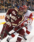 Isaac MacLeod (BC - 7), Robbie Baillargeon (BU - 19) - The Boston College Eagles defeated the Boston University Terriers 3-1 (EN) in their opening round game of the 2014 Beanpot on Monday, February 3, 2014, at TD Garden in Boston, Massachusetts.