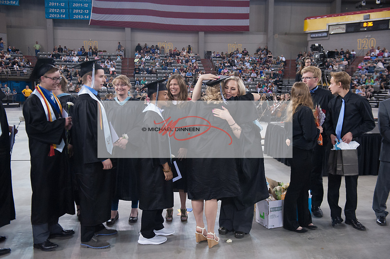1180 <br /> <br /> Chugiak faculty members congratulate graduates.  Photo for the Star by  Michael Dinneen.