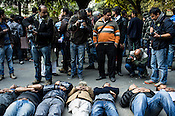 Photojournalists take photos of protesting people of all ages during a peaceful protest at Jantar Mantar in New Delhi, India.