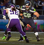 Seattle Seahawks Breno Giacomini (68) sets up to block Minnesota Vikings defensive end BrianRobinson (96) at CenturyLink Field in Seattle, Washington on  November 17, 2013.  The Seahawks beat the Vikings 41-20.  ©2013.  Jim Bryant. All Rights Reserved.