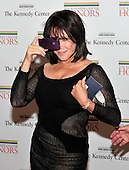 Michelle Lee photographs the photographers with her iPhone as she arrives for the formal Artist's Dinner honoring the recipients of the 2011 Kennedy Center Honors hosted by United States Secretary of State Hillary Rodham Clinton at the U.S. Department of State in Washington, D.C. on Saturday, December 3, 2011. The 2011 honorees are actress Meryl Streep, singer Neil Diamond, actress Barbara Cook, musician Yo-Yo Ma, and musician Sonny Rollins..Credit: Ron Sachs / CNP