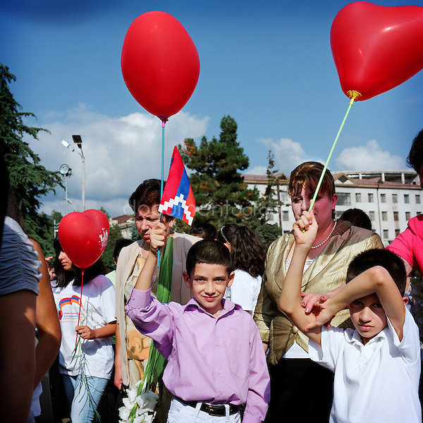 2nd of September 2011: 20th anniversary of the independance of Nagorno-Karabakh. Children, scouts groups, teachers, families... walk together from the Calsavoi place in Stepanakert up to the Memorial Complex where they'll gather together and put a flower near the war memorial.