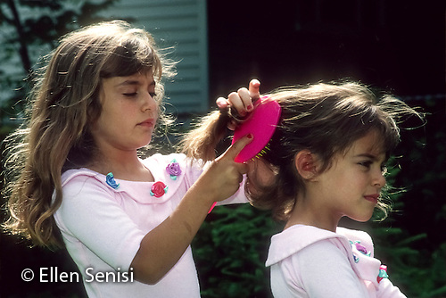 MR / Schenectady NY. Girl (7) brushes her sister's (5) hair. Book original from Brothers and Sisters. MR: Cam1, Cam3. © Ellen B. Senisi (Ellen B. Senisi)