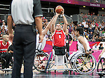 LONDON, ENGLAND 30/08/12: Yvon Rouillard competes in the Men's Wheelchair Basketball preliminary round CAN vs. JPN at the London 2012 Paralympic Games at the Basketball Arena (Photo by: Courtney Pollock/Canadian Paralympic Committee)