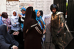 Soldiers stand guard as Egyptian women cue in front of a polling station in order to take part in the first truly democratic Presidential election in Egypt's history May 23, 2012 in Cairo, Egypt. The election will take place over two days, May 23, and 24th 2012.  (Photo by Scott Nelson)