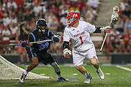 College Park, MD - April 29, 2017: Maryland Terrapins Matt Rambo (1) keeps the ball away from Johns Hopkins Blue Jays Nick Fields (91) during game between John Hopkins and Maryland at  Capital One Field at Maryland Stadium in College Park, MD.  (Photo by Elliott Brown/Media Images International)