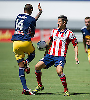 CARSON, CA - August 25, 2013: Chivas USA defender Carlos Borja (5) during the Chivas USA vs New York Red Bulls match at the StubHub Center in Carson, California. Final score, Chivas USA 3, New York Red Bulls 2.
