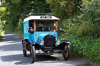 Well-preserved veteran Model T Ford auto touring along country lane in The Cotswolds, UK