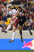 John Wolyniec (15) of the New York Red Bulls and Bruno Aguiar (2) of Santos FC go up for a header during the second half of a friendly between Santos FC and the New York Red Bulls at Red Bull Arena in Harrison, NJ, on March 20, 2010. The Red Bulls defeated Santos FC 3-1.