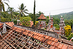 A tiled rooftop under construction reflects the continuing maintenance needed to sustain the Bramavihara-Arama Buddhist Temple, which soars above its town in northern Bali, Indonesia.