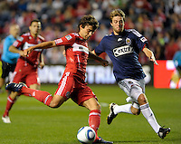 Chicago midfielder Baggio Husidic (9) attempts a shot while being defended by Chivas midfielder Blair Gavin (18).  The Chicago Fire tied Chivas USA 1-1 at Toyota Park in Bridgeview, IL on May 1, 2010.