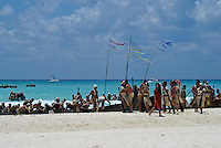 Canoes and paddlers being greeted as they arrive at Playa del Carmen or Xamanha during the Sacred Mayan Journey 2011 event, Riviera Maya, Quintana Roo, Mexico