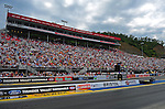 Jun. 17, 2011; Bristol, TN, USA: NHRA fans fill the grandstands during qualifying for the Thunder Valley Nationals at Bristol Dragway. Mandatory Credit: Mark J. Rebilas-