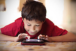 Boy playing on tablet - EXCLUSIVELY AVAILABLE HERE