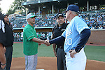 16 May 2016: Notre Dame head coach Mik Aoki (left) shakes hands with UNC head coach Mike Fox (30) as home plate umpire Olindo Mattia (center) watches. The University of North Carolina Tar Heels hosted the University of Notre Dame Fighting Irish in an NCAA Division I Men's baseball game at Boshamer Stadium in Chapel Hill, North Carolina.