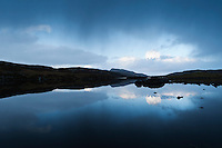Rain clouds over small loch, Isle of Lewis, Western Isles, Scotland