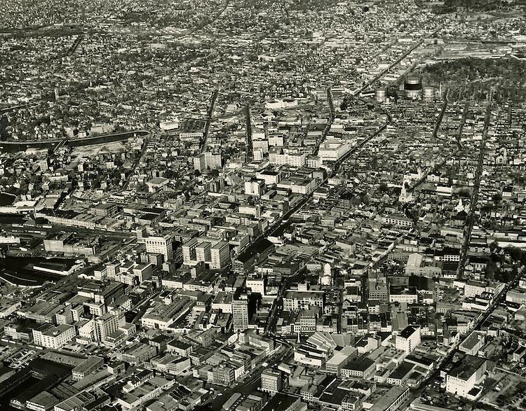 1949 November 30..Historical...Aerial view looking North at downtown..PHOTO CRAFTSMEN INC..NEG# 7-100.NRHA# 761-A..