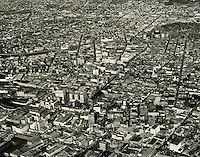 1949 November 30..Historical...Aerial view looking North at downtown..PHOTO CRAFTSMEN INC..NEG# 7-100.NRHA# 761-A..