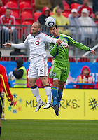 25 April 2010: Toronto FC forward Chad Barrett #19 and Seattle Sounders defender Patrick Ianni #4 in action during a game between the Seattle Sounders and Toronto FC at BMO Field in Toronto..Toronto FC won 2-0....