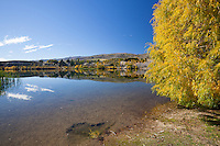 Autumn reflection on the Kawarau River at Bannockburn near Cromwell, Central Otago, New Zealand - stock photo, canvas, fine art print