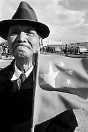 11 Nov 1971 --- A supporter of the People's Republic of China waves the official flag to welcome the 46 delegates arriving at JFK airport. On October 25, 1971 the United Nations General Assembly admitted the People's Republic of China as a U.N. and permanent member of the Security Council, expelling the Republic of China (or nationalist Taiwan). --- Image by © JP Laffont
