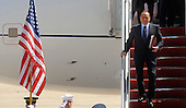 President  Silvio Berlusconi of Italy arrives with his delegation April 12, 2010 at Andrews Air Force Base in Maryland. Leaders from around the world including nuclear powers are meeting in Washington this week for a two-day nuclear security summit. .Credit: Olivier Douliery / Pool via CNP