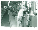Martin DiCorpo, President of Harper-Leader Inc., inspects parts on a mechanized electroplating line at the firm's South Main Street plant. With about 69 employees and $8 million in sales, Harper-Leader is one of the larger electroplaters in the area. 26 June 1984.