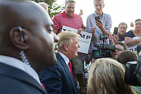 Real estate mogul and Republican presidential candidate Donald Trump greets supporters after speaking to supporters at a rally at the Weirs Beach Community Center in Laconia, New Hampshire.