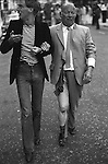 Notting hill Carnival London 1970's. Gay couple, the older man was attacked and robbed of his wallet. England.Queer Basking was a term used at the time when gay men were often seen as an easy target for homophobic youths.