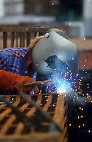 Man using arc welder.