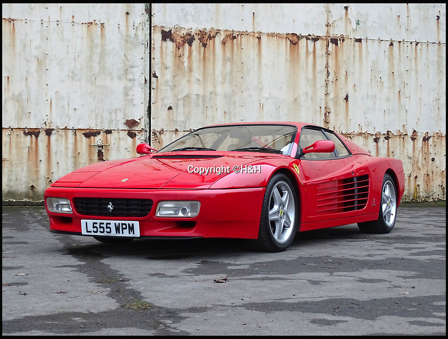 BNPS.co.uk (01202 558833)<br /> Pic: H&amp;H/BNPS<br /> <br /> Ferrari 512 TR estimated at &pound;155,000.<br /> <br /> A stunning sports car owned by David Beckham has emerged in a sale of eleven Ferraris - making a whole football team of motors. <br /> <br /> Golden Balls owned the 360 Spider in the early noughties when he was at the peak of his powers ahead of a big money move to Real Madrid. <br /> <br /> Becks, a renowned car nut, kitted the 2001 motor out with an F1-style gearbox, carbon fibre backed racing seats, tinted windows and custom bodywork.<br /> <br /> The car's combined worth is a whopping &pound;2,200,000.