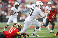 College Park, MD - October 1, 2016: Purdue Boilermakers quarterback David Blough (11) is tackled by Maryland Terrapins defensive end Melvin Keihn (15) during game between Purdue and Maryland at  Capital One Field at Maryland Stadium in College Park, MD.  (Photo by Elliott Brown/Media Images International)