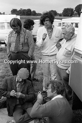 Gypsies playing cards at the Derby Day Horse race day, Epsom Downs, England 1974