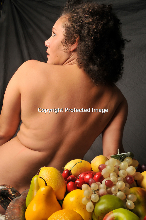 Photograph of a  woman with fruit