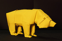 New York, NY, USA - June 22, 2012: An origami creation on display at the OrigamiUSA 2012 convention exhibition held at Fashion Institute of Technology in New York City. This Origami bear was designed and folded out of one sheet of square paper by Sipho Mabona, an Origami artist living in Switzerland. Mabona was a guest of honor at the convention.