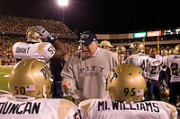 """Pitt defensive line coach Greg Gattuso gives instructions to Rashaad Duncan and Ernest """"Mick"""" Williams. The Pitt Panthers upset the West Virginia Mountaineers 13-9 on December 01, 2007 in the 100th edition of the Backyard Brawl at Mountaineer Field, Morgantown, West Virginia."""