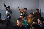 15/11/14. Alqosh, Iraq. Wassam (centre right, yellow shirt) raises his hand to answer a question at the Alqosh School. Three of the children from the orphanage currently study at the school, which was founded in 1926.