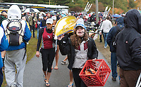 October 24, 2010 - Boston, MA - Hannah Pratt BHS '13, leads the Alington-Belmont varisity women's crew team through the crowd carrying their boat during their first Head of the Charles Regatta on Sunday. Pratt is the team's coxswain. The cox commands the team and steers the boat during the race. (Photos/Matt Wright 2010)