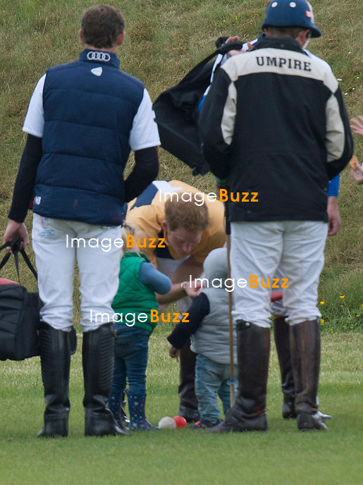 SOON TO BE UNCLE, PRINCE HARRY<br /> gets some practice playing with little children.<br /> Prince William and brother Prince Harry played in a charity match at the Beaufort Polo Club_16/06/2013