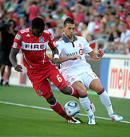 Chicago Fire defender Jalil Anibaba (6) takes the ball away from Toronto midfielder Peri Marosevic (70).  The Chicago Fire defeated Toronto FC 2-0 at Toyota Park in Bridgeview, IL on August 21, 2011.